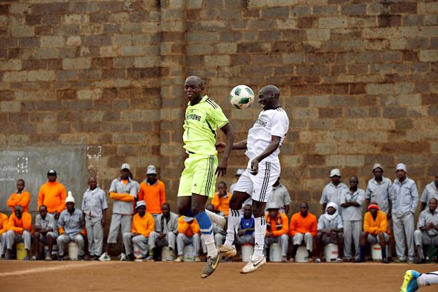 <p>Players jump for the ball during a mock World Cup soccer match between Russia and Saudi Arabia at the Kamiti Maximum Security Prison, near Nairobi, Kenya, on June 14, 2018. (Photo: Baz Ratner/Reuters) </p>