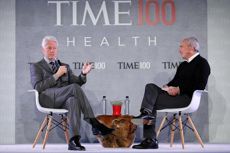Former U.S. President Bill Clinton (L) speaks with CEO of the Lawrence J. Ellison Institute for Transformative.Medicine of USC and TIME 100 Health Summit Co-Chair, Dr. David Agus, onstage during the TIME 100 Health Summit at Pier 17 in New York City on Oct. 17, 2019. | Brian Ach—Getty Images for TIME 100 Health
