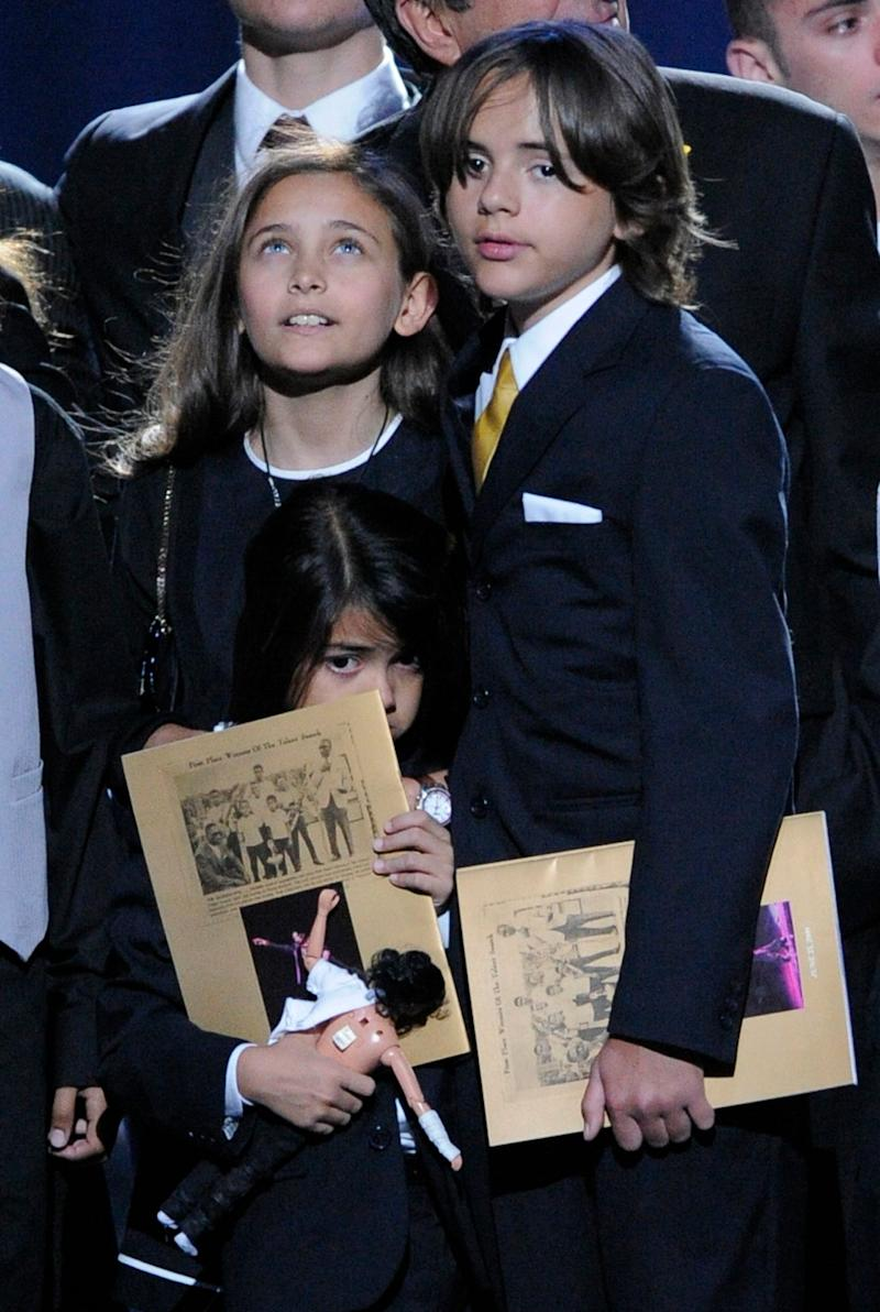 Paris Jackson with her older brother Prince Jackson, and her younger brother, Prince Michael Jackson II, at their father's public memorial service at the Staples Center on July 7, 2009, in Los Angeles.