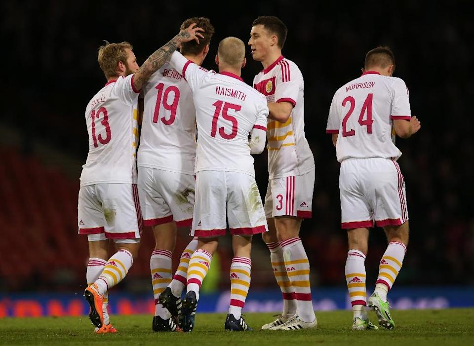 Scotland defender Christophe Berra (2nd L) celebrates with teammates after scoring the opening goal during the international friendly match against Northern Ireland at Hampden Park in Glasgow on March 25, 2015 (AFP Photo/Ian Macnicol)