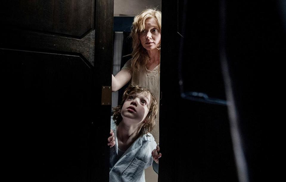 """<p>Jennifer Kent's striking directorial debut introduces a new boogeyman guaranteed to haunt your late-night dreams and wakings. Introduced as the macabre main character of an Edward Gorey-esque children's book, the Babadook (dook dook dook) acquires a life-sized menace over the course of the film, as an already sanity-challenged mother (the remarkable Essie Davis) slides deeper into madness. Interestingly, this creature has acquired a less-terrifying identity outside of the movie, <a href=""""https://www.newyorker.com/culture/rabbit-holes/the-babadook-is-a-frightening-fabulous-new-gay-icon"""" rel=""""nofollow noopener"""" target=""""_blank"""" data-ylk=""""slk:becoming an LGBT icon"""" class=""""link rapid-noclick-resp"""">becoming an LGBT icon</a>. (Available on Netflix.) — <em>E.A.</em> (Photo: IFC Midnight/courtesy Everett Collection) </p>"""