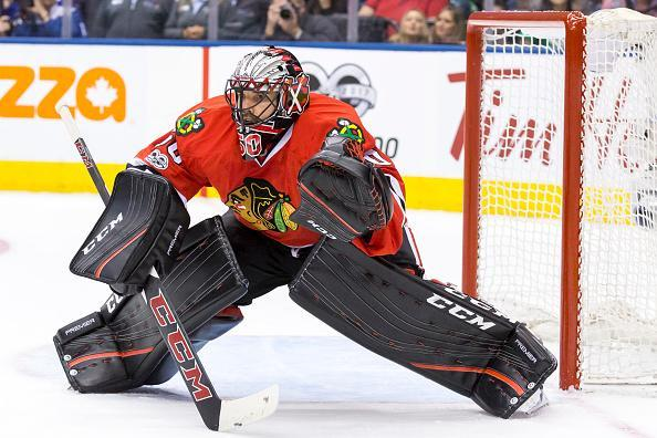 """<a class=""""link rapid-noclick-resp"""" href=""""/nfl/players/28857/"""" data-ylk=""""slk:Corey Crawford"""">Corey Crawford</a> of the Chicago Blackhawks keeps his eyes on the puck against the Toronto Maple Leafs during the third period at the Air Canada Centre on March 18, 2017 in Toronto, Ontario, Canada. (Getty Images)"""