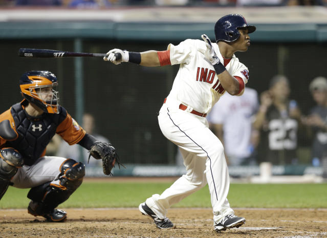 Cleveland Indians' Jose Ramirez follows through on an RBI single off Baltimore Orioles starting pitcher Ubaldo Jimenez in the fifth inning of a baseball game, Saturday, Aug. 16, 2014, in Cleveland. Chris Dickerson scored on the play. Orioles catcher Caleb Joseph is at left. (AP Photo/Tony Dejak)