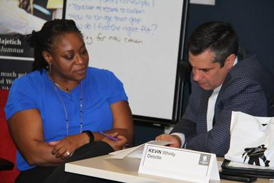 A wounded warrior receives feedback on her resume at a Deloitte employment boot camp at Wounded Warrior Project's headquarters in Jacksonville, Florida.