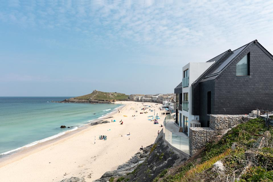 A former council house has been transformed into one of Britain's most luxurious holiday homes. (SWNS)