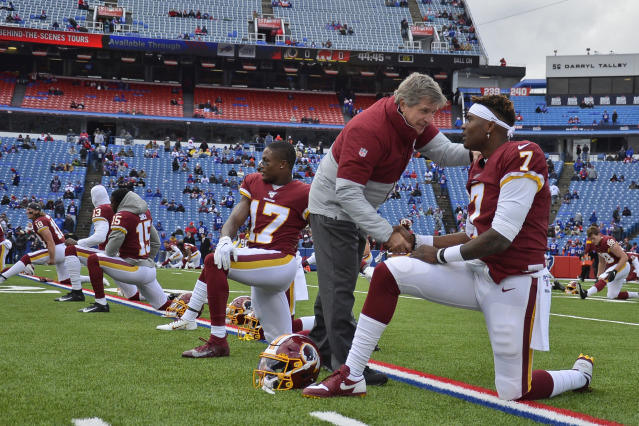 FILE - In this Nov. 3, 2019, file photo, Washington Redskins head coach Bill Callahan, left, talks with quarterback Dwayne Haskins before an NFL football game in Orchard Park, N.Y. The Redskins at the bye week of a lost season are a team without a definitive answer at quarterback, answers to questions on offense and defense and a visible organizational plan for the future. Callahan has repeatedly set the expectation at winning the next game and said hes receiving no direction from the front office on how to develop young players for the next few years. (AP Photo/Adrian Kraus, File)