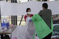 Medical personnel carry out disinfection protocol and equipment removal after carrying out tests for possible detection of possible COVID-19 in Lomas de San Lorenzo, Iztpalapa, on July 15, 2020, one of the neighborhoods in Mexico City that returned to a lockdown due to the high number of infections by coronavirus in the capital. (Photo by Gerardo Vieyra/NurPhoto via Getty Images)