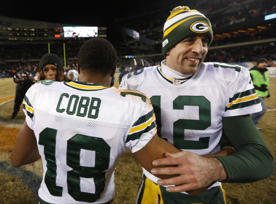 Green Bay Packers quarterback Aaron Rodgers (12) celebrates with wide receiver Randall Cobb (18) after an NFL football game against the Chicago Bears, Sunday, Dec. 29, 2013, in Chicago. Cobb made the game-winning touchdown reception in the Packers' 33-28 win to capture the NFC North title. (AP Photo/Charles Rex Arbogast)
