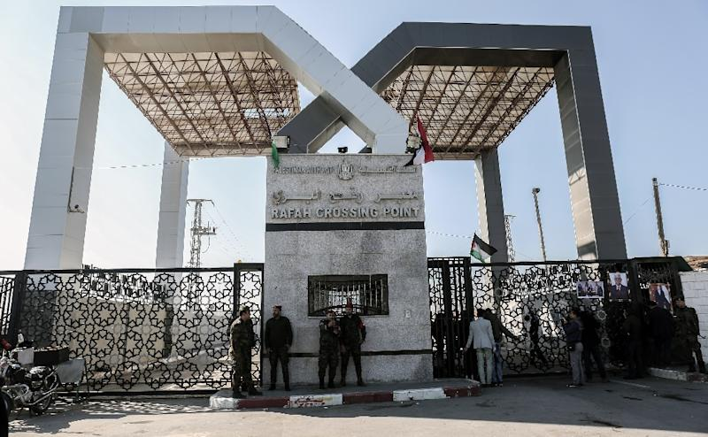 Palestinian security forces loyal to Hamas stand guard outside the Rafah border crossing with Egypt, under the control of the Palestinian Authority, on December 16, 2017