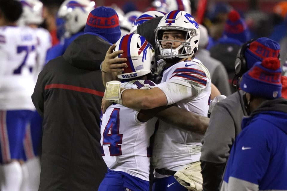 Buffalo Bills quarterback Josh Allen, right, hugs teammate Stefon Diggs during the second half of the AFC championship NFL football game against the Kansas City Chiefs, Sunday, Jan. 24, 2021, in Kansas City, Mo. (AP Photo/Jeff Roberson)