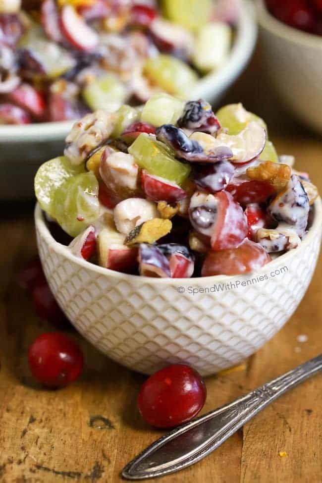 """<p>This twist on the traditional Waldorf Salad is lightened up with yogurt, and uses both dried and fresh cranberries for a festive touch. </p><p><strong>Get the recipe at <a href=""""http://www.spendwithpennies.com/cranberry-waldorf-salad/"""" rel=""""nofollow noopener"""" target=""""_blank"""" data-ylk=""""slk:Spend With Pennies"""" class=""""link rapid-noclick-resp"""">Spend With Pennies</a>.</strong><br></p>"""