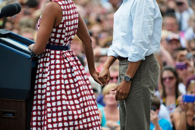 Michelle Obama and President Barack Obama speak during a rally at Alliant Energy Amphitheater in Dubuque, Iowa on Aug. 15, 2012.