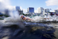 Sharon van Rouwendaal, of the Netherlands, competes in the women's marathon swimming event at the 2020 Summer Olympics, Wednesday, Aug. 4, 2021, in Tokyo. (AP Photo/David Goldman)
