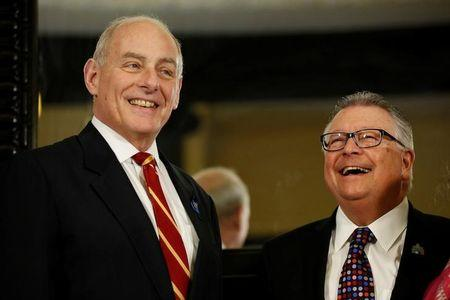 U.S. Homeland Security Secretary John Kelly (L) takes part in a group photo with Canada's Public Safety Minister Ralph Goodale on Parliament Hill in Ottawa, Ontario, Canada, March 10, 2017. REUTERS/Chris Wattie