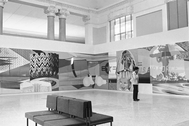 "FILE - This Oct. 30, 1966 file photo shows ""Theme With Variations,"" American artist James Rosenquist's 92-foot long and 10-foot high painting, on display at Rome's National Gallery of Modern Arts. The work, consisting of 51 panels placed one aside another or overlapping, has as central figure the U.S. jet bomber ""F-111."" (AP Photo/Jim Pringle)"