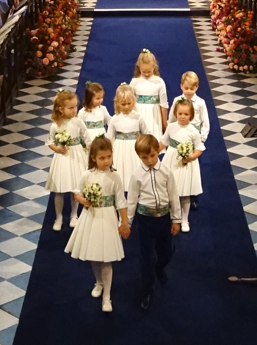 WINDSOR, ENGLAND - OCTOBER 12: Bridesmaids and page boys including Princess Charlotte of Cambridge, Savannah Phillips, Prince George of Cambridge, Maud Windsor, Isla Phillips, Mia Tindall, Theodora Williams and  Louis de Givenchy attend the wedding of Princess Eugenie of York and Jack Brooksbank at St. George's Chapel on October 12, 2018 in Windsor, England.  (Photo by Jonathan Brady - WPA Pool/Getty Images)