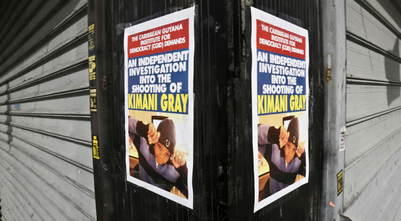 """Storefront posters with a picture of police shooting victim Kimani """"Kiki"""" Gray, calls for an """"independent investigation"""" on Thursday, March 14, 2013 in the East Flatbush neighborhood of Brooklyn, N.Y. The 16-year-old was shot to death on a Brooklyn street last Saturday night by plainclothes police officers who claim the youth pointed a .38-caliber revolver at them, while Gray's family syas he was unarmed. (AP Photo/Bebeto Matthews)"""