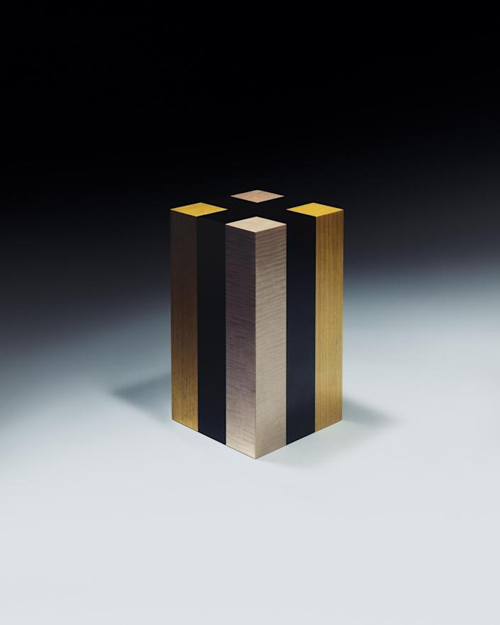 A golden steel stool featured in Jonathan Saunders' debut furniture collection.