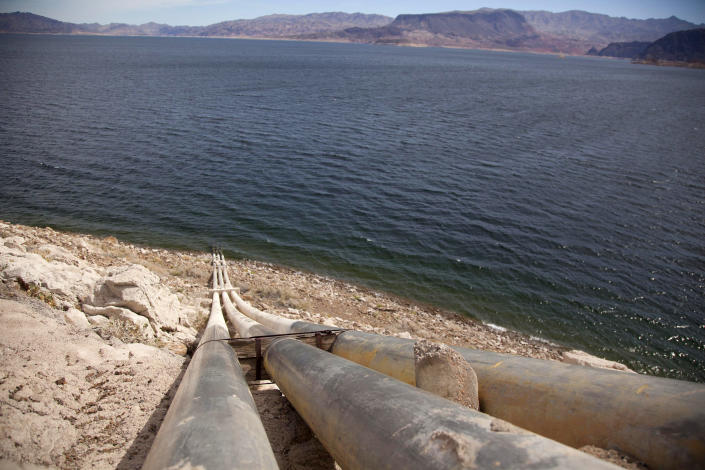 FILE - This March 23, 2012, file photo, shows pipes extending into Lake Mead well above the high water mark near Boulder City, Nev. A plan by Utah could open the door to the state pursuing an expensive pipeline that critics say could further deplete the lake, which is a key indicator of the Colorado River's health. (AP Photo/Julie Jacobson, File)