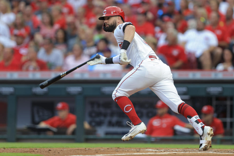 Cincinnati Reds' Jesse Winker heads to first on a two-run double during the second inning of the team's baseball game against the St. Louis Cardinals in Cincinnati, Saturday, July 24, 2021. (AP Photo/Aaron Doster)
