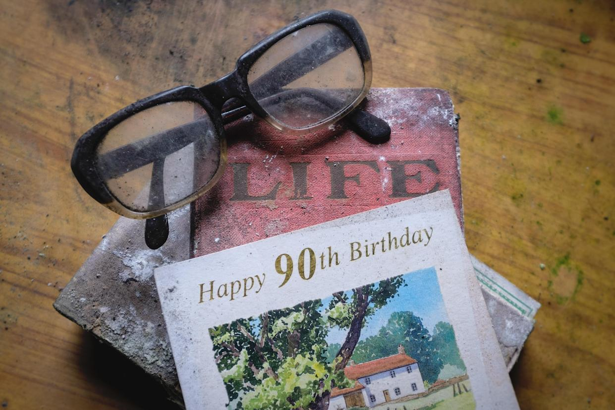 Spectacles and a 90th birthday card are seen inside an abandoned home in Northern Ireland on March 12, 2018. (Photo: Unseen Decay/Mercury Press/Caters News)