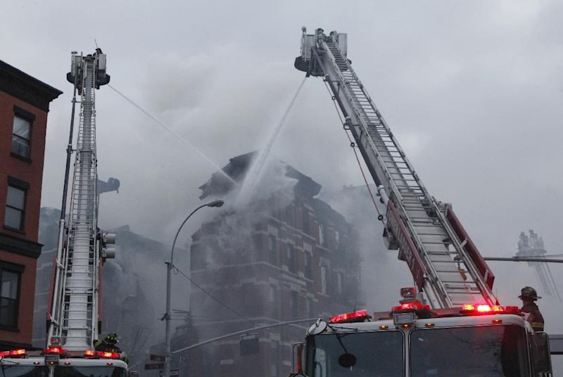 When three buildings collapsed and ignited a blaze in New York, a smartphone app brought the live video feed to anyone online wanting to watch (AFP Photo/Kena Betancur)