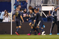 Philadelphia Union's Marco Fabian (10) celebrates his goal with teammates during extra time of an MLS soccer Eastern Conference first-round playoff match, Sunday, Oct. 20, 2019, in Chester, Pa. The Union won 4-3 in extra time. (AP Photo/Chris Szagola)