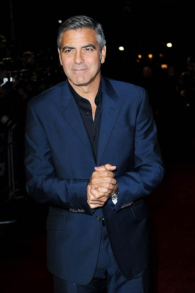 "George Clooney is competing hard to play late Apple founder Steve Jobs in an upcoming movie, reports Now. The mag reveals he's ""battling it out"" with his former ""E.R."" co-star Noah Wyle, who's also campaigning for the role. For why Clooney wants the part so badly, and what he's willing to do to make sure Wyle doesn't get it, log on to <a target=""_blank"" href=""http://www.gossipcop.com/george-clooney-steve-jobs-movie-noah-wyle/"">Gossip Cop.</a> (10/19/2011)"