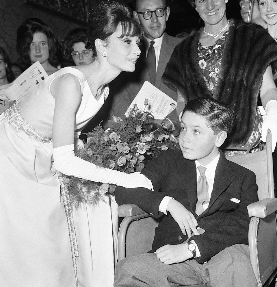 <p>Audrey Hepburn meets a young fan at the red carpet premiere of <em>Breakfast at Tiffany's</em> in 1961.</p>
