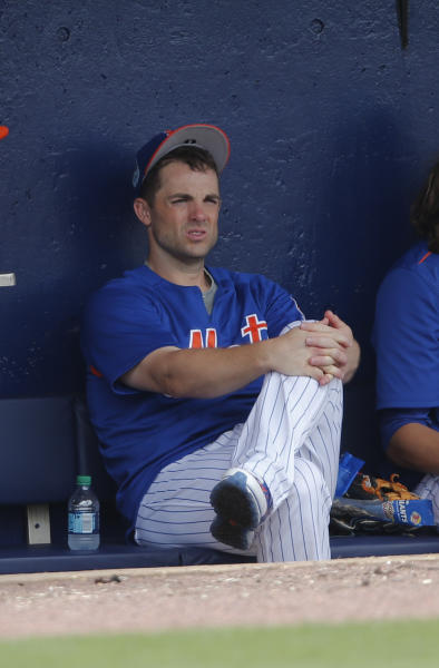 FILE - In this March 24, 2017, file photo, New York Mets third baseman David Wright (5) sits on the bench during a spring training baseball game against the Houston Astros, in Port St. Lucie, Fla. Mets captain David Wright wont participate in baseball activities for two months because of back and shoulder issues, another setback in his attempt to return from injuries that have sidelined him for two years, and New York star outfielder Yoenis Cespedes is sidelined after hurting a wrist. New York made the announcements Tuesday, March 13, 2018, a day after Wright was examined by Dr. Robert Watkins in Los Angeles.(AP Photo/John Bazemore, File)