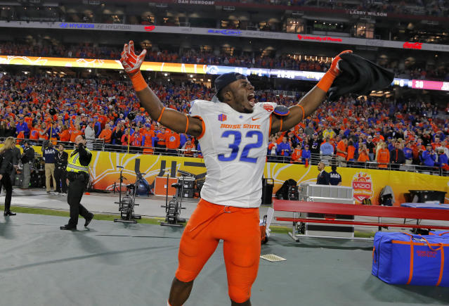 Boise State defensive end Rondell McNair (32) celebrates after the the Fiesta Bowl NCAA college football game against Arizona, Wednesday, Dec. 31, 2014, in Glendale, Ariz. Boise State won 38-30. (AP Photo/Rick Scuteri)