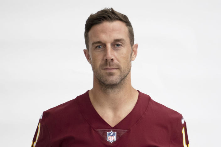 FILE - This is a 2020 file photo showing Alex Smith of the Washington NFL football team. Alex Smith is retiring from the NFL after making an improbable comeback from a broken leg. Smith announced his retirement Monday, April 19, 2021, on Instagram, saying he still has plenty of snaps left him just shy of his 37th birthday but is calling it quits to enjoy time with his family. (AP Photo/File)