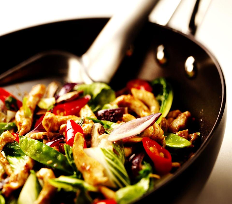 <p>Whatever your go-to chicken (or shrimp) stir-fry recipe is, toss some PB powder into whatever source you'd normally add. Scatter a few whole peanuts, if you have them, atop the finished dish for some crunch.</p>