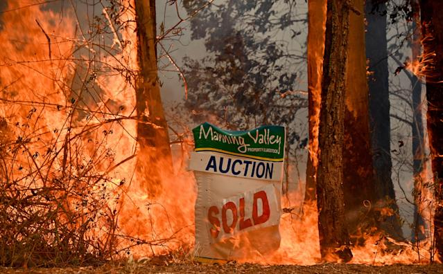 "A bushfire burns outside a property near Taree, 350km north of Sydney on November 12, 2019. - A state of emergency was declared on November 11, 2019 and residents in the Sydney area were warned of ""catastrophic"" fire danger as Australia prepared for a fresh wave of deadly bushfires that have ravaged the drought-stricken east of the country. (Photo by PETER PARKS / AFP) (Photo by PETER PARKS/AFP via Getty Images)"