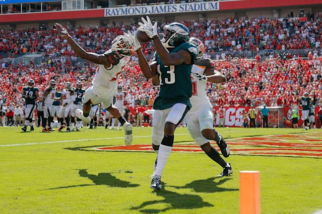 <p>Nelson Agholor #13 of the Philadelphia Eagles catches a touchdown pass against the Tampa Bay Buccaneers during the second half at Raymond James Stadium on September 16, 2018 in Tampa, Florida. (Photo by Michael Reaves/Getty Images) </p>