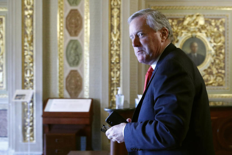 Acting White House chief of staff Mark Meadows walks on Capitol Hill in Washington, Tuesday, March 24, 2020, as the Senate works to pass a coronavirus relief bill. (AP Photo/Patrick Semansky)