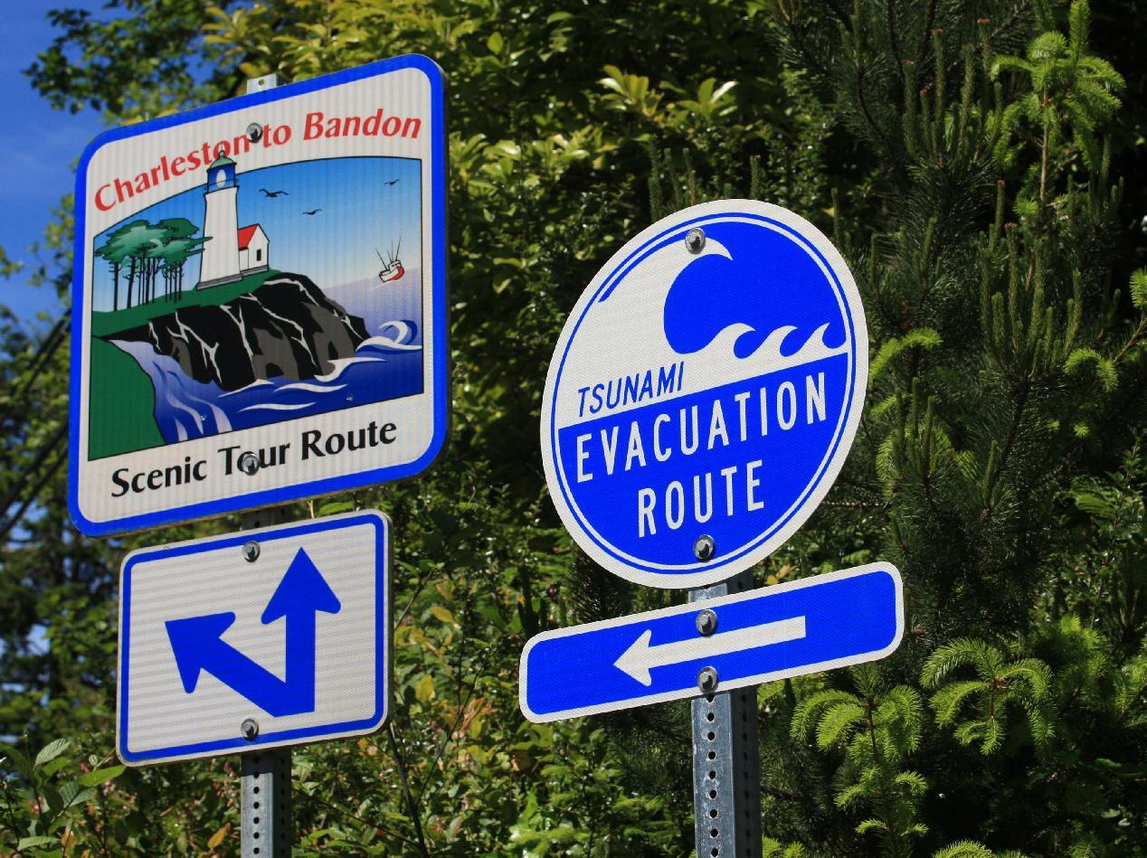 A Tsunami evacuation route sign is shown Thursday, May 31, 2012, Charleston, Ore. Thousands of people in three Oregon coastal communities are holding their first tsunami evacuation drill, stirred to action by the 2011 tsunami that devastated coastal towns in Japan. When the tsunami from Japan hit last year, residents had hours to get ready, and severe damage was limited to harbors such as Crescent City, Calif. One person was swept away and died. (AP Photo/Rick Bowmer)