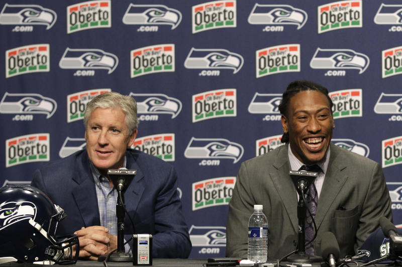 FILE - In this April 28, 2012, file photo, Seattle Seahawks top NFL football draft pick, Bruce Irvin and Seahawks head football coach Pete Carroll, left, take questions from reporters after Irvin was introduced in Renton, Wash. Irvin is thrilled to be back where his NFL journey started. Irvin jumped at the chance to return to Seattle this offseason, but his reunion with the Seahawks comes with the expectation he can help a lackluster pass rush. (AP Photo/Ted S. Warren, File)
