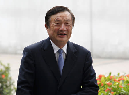 Huawei CEO and founder Ren Zhengfei walks inside Huawei's headquarters in Shenzhen