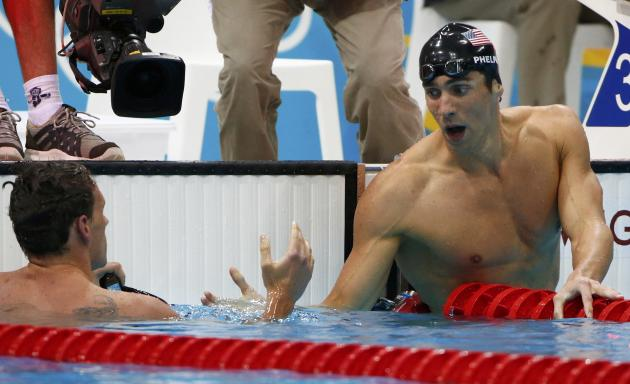 Michael Phelps, right, shakes hands with Ryan Lochte after winning the 200 IM. (Reuters)