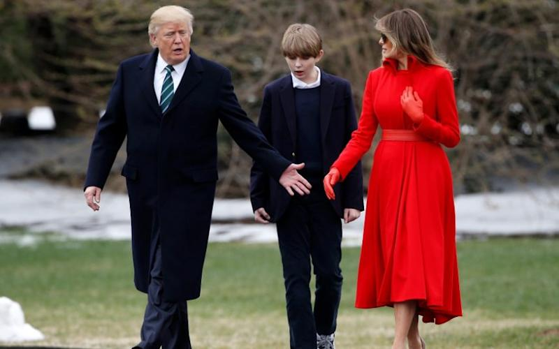 U.S. President Donald Trump and U.S. first lady Melania Trump walk with their son Barron to Marine One at the White House in Washington - Credit: Reuters