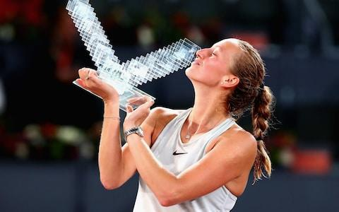 Kvitova kisses the Madrid Open trophy - Credit: Getty Images