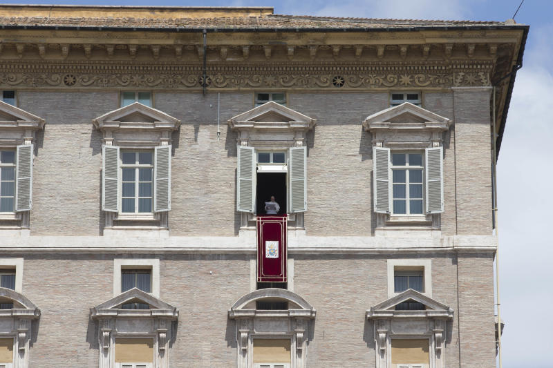 Pope Francis blesses the crowd during the Angelus noon prayer , from the window of his studio overlooking St. Peter's Square, at the Vatican, Sunday, June 2, 2013. (AP Photo/Andrew Medichini)