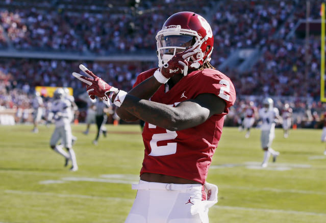 FILE - In this Oct. 27, 2018, file photo, Oklahoma wide receiver CeeDee Lamb (2) celebrates a touchdown during an NCAA college football game against Kansas State in Norman, Okla. Oklahoma quarterback Kyler Murray has star receivers in Marquise Brown and Lamb, yet he doesnt hesitate to throw to other options.(AP Photo/Sue Ogrocki, File)
