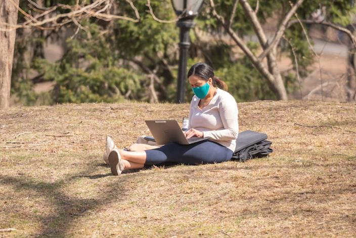 woman working remote mask