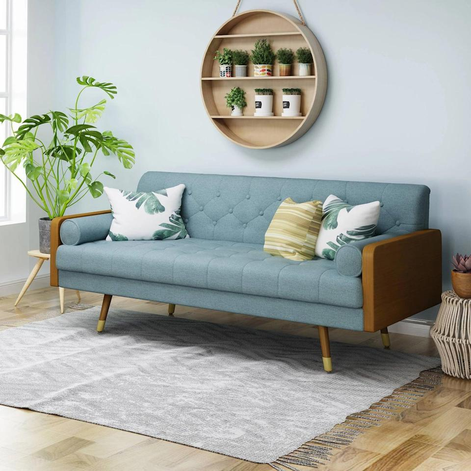 <p>We love the vintage style of this <span>Christopher Knight Home Jalon Mid Century Modern Sofa</span> ($331, originally $510).</p>