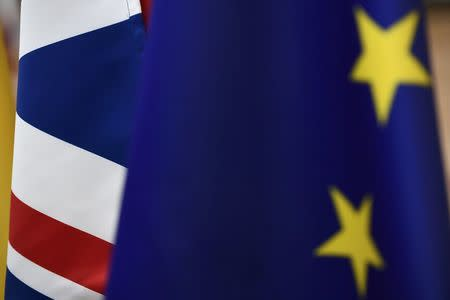 Britain's Union flag and the European flag on display ahead of the EU summit in Brussels