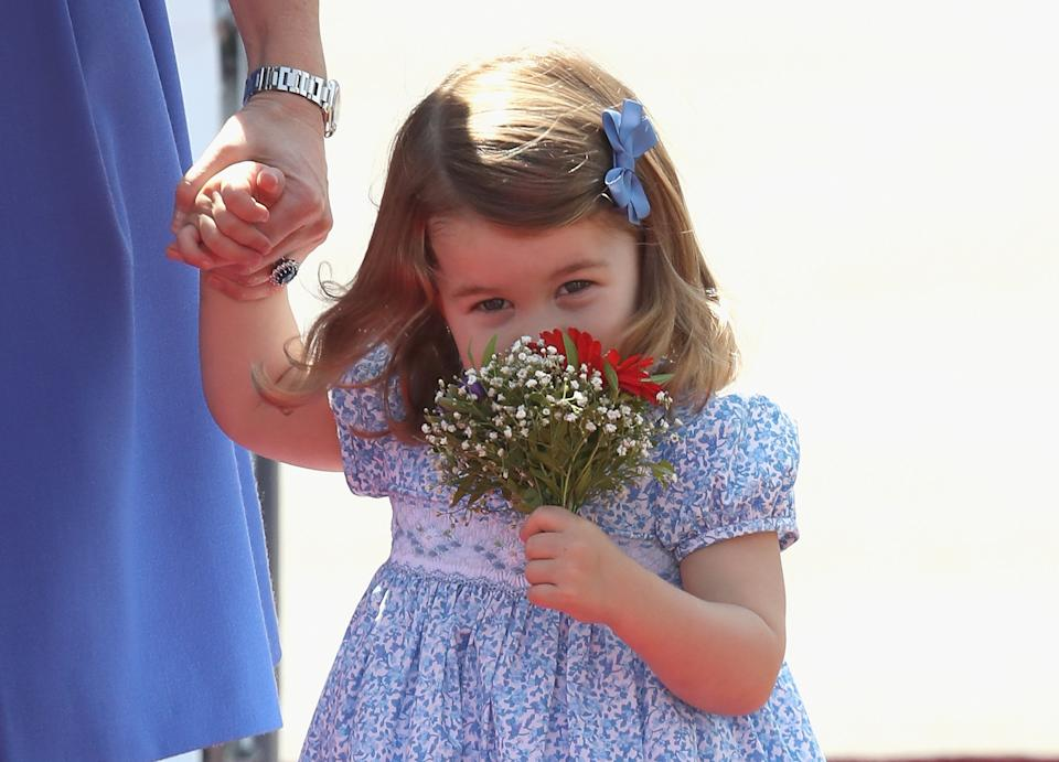 <p>Charlotte received a posy of her own when she arrived with her family on the royal tour of Germany in 2017 - how adorable! (Getty Images)</p>