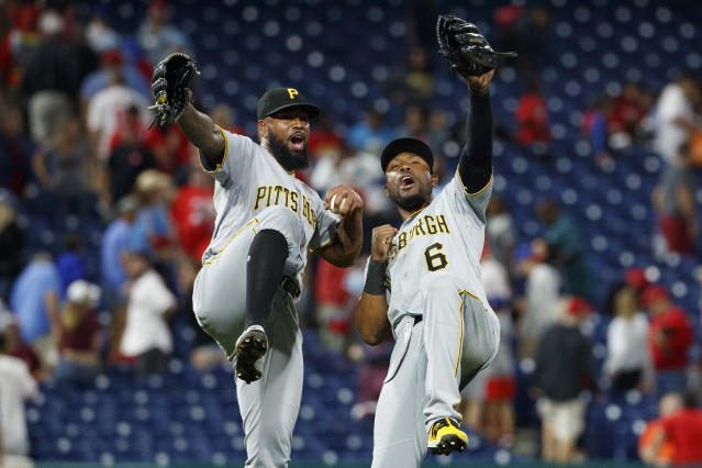 Pittsburgh Pirates relief pitcher Felipe Vazquez, left, and center fielder Starling Marte celebrate after the team's baseball game against the Philadelphia Phillies, Tuesday, Aug. 27, 2019, in Philadelphia. Pittsburgh won 5-4. (AP Photo/Matt Slocum)