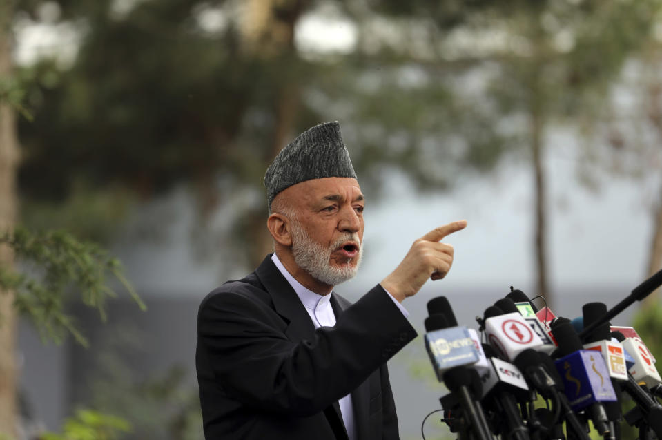 Afghanistan's former President Hamid Karzai speaks during a news conference in Kabul, Afghanistan, Tuesday, July 13, 2021. Former President Karzai calls on both the Afghan government and the Taliban to resume negotiations and end fighting in the country. (AP Photo/Rahmat Gul)